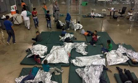 A CBP photo shows children resting at a McAllen, Texas, detention facility.