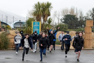Young people run through gates