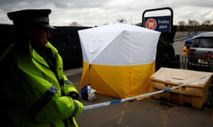 A police officer stands at a cordon placed around a payment machine covered by a tent in a supermarket car park near to where former Russian intelligence agent Sergei Skripal and his daughter Yulia were found poisoned in Salisbury