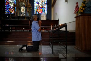 A Catholic worshipper prays during the Ash Wednesday service at the San Salvador Cathedral, in El Salvador