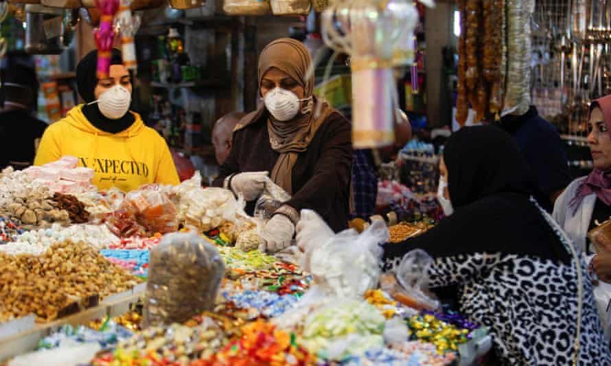 Women shopping in Baghdad after lockdown measures were partially eased