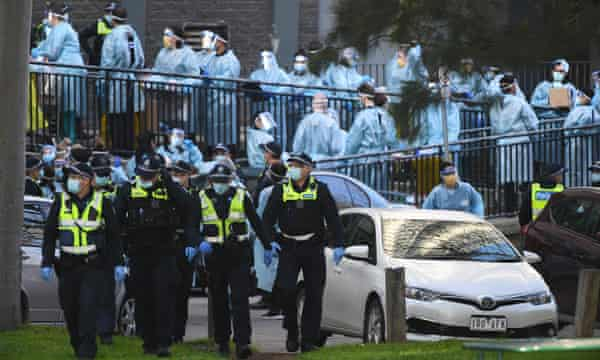 Police and health workers outside the North Melbourne block.