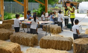 Are you sitting comfortably? … schoolkids on the straw bales.