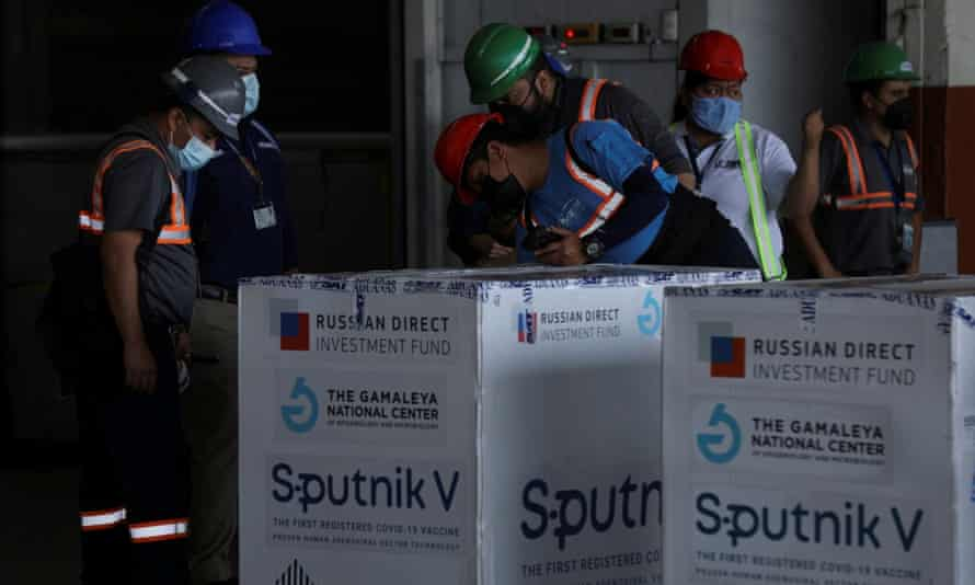 Workers inspect the first batch of Sputnik V vaccines in Guatemala City in May.