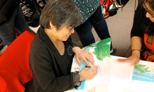 Author Candy Gourlay signs books for delegates at the Guardian Education Centre Reading for pleasure conference 28 March 2019