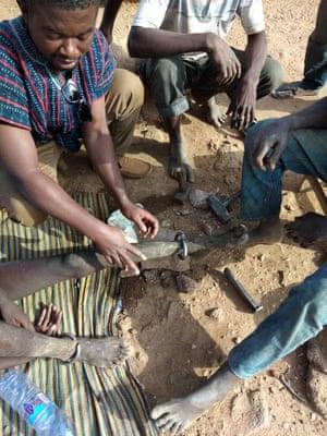 Nurse Stephen Asante freeing Baba.