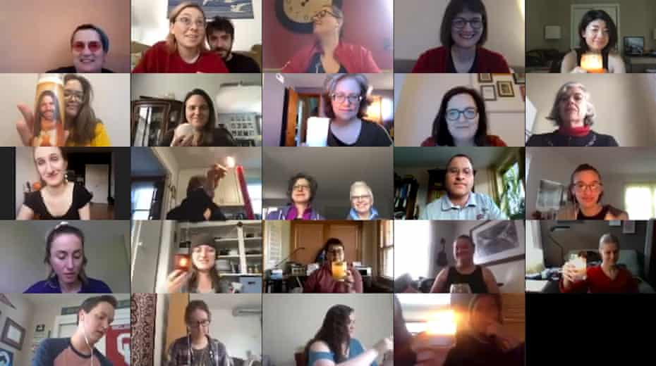 In March 2020, members of a virtual community choir light candles from their homes as seen from Brooklyn, New York.