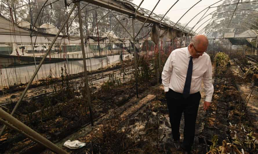 Scott Morrison tours a bushfire damaged farm in January. The PM has announced a royal commission to look at mitigation, adaptation and an expanded role for the military in natural disasters.