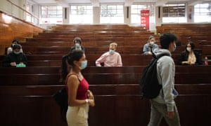 Students wait to start exams at the Universidad Complutense Law School in Madrid, Spain.