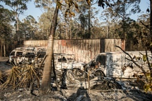 The remains of three vehicles by a house that was destroyed on 8 November in Spicers Road, Rainbow Flat, NSW.