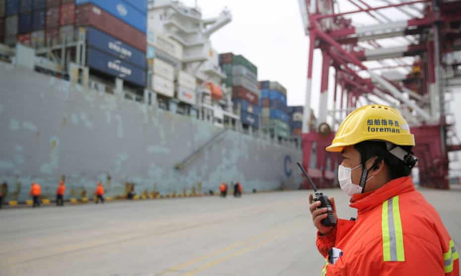 A docker wears a face mask at the Chinese port of Qingdao