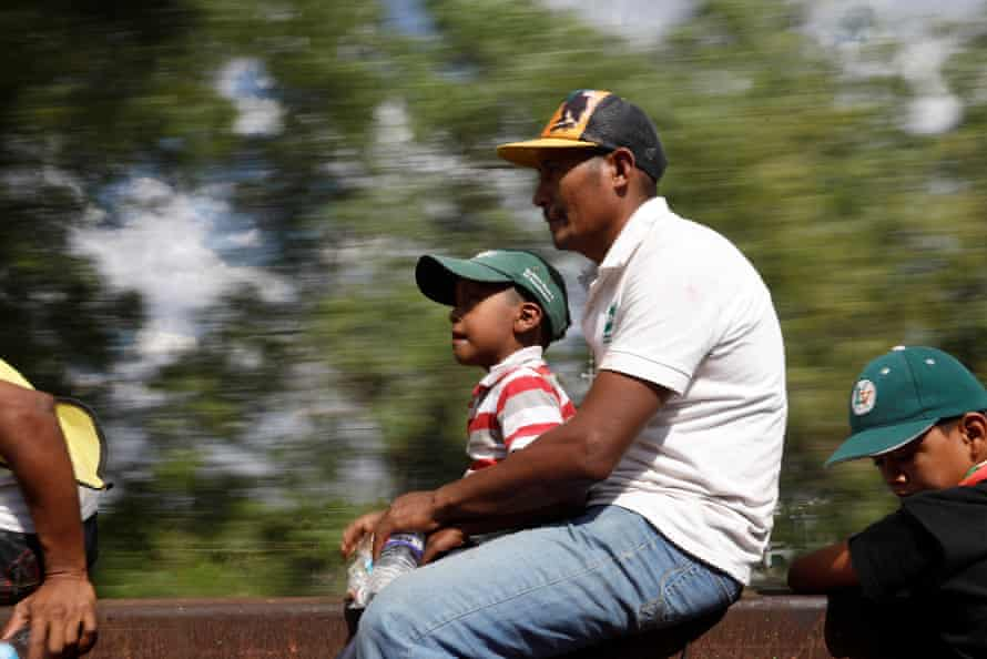 A father and son together on a freight train in Hidalgo state, 14 April