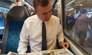 The Plaid Cymru leader, Adam Price, on board the Cardiff to Holyhead train