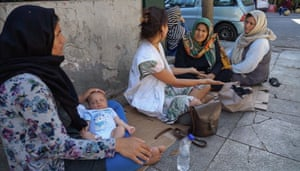 Homeless refugees in Victoria Square, Athens, with MSF health worker
