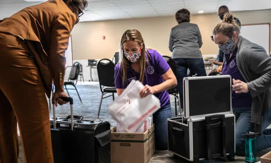 Officials in Mason, Michigan handle ballot papers on election day.