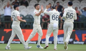 Jimmy Anderson is congratulated by England teammates after taking the wicket of Zubayr Hamza late on day four of of the second Test against South Africa in Cape Town.