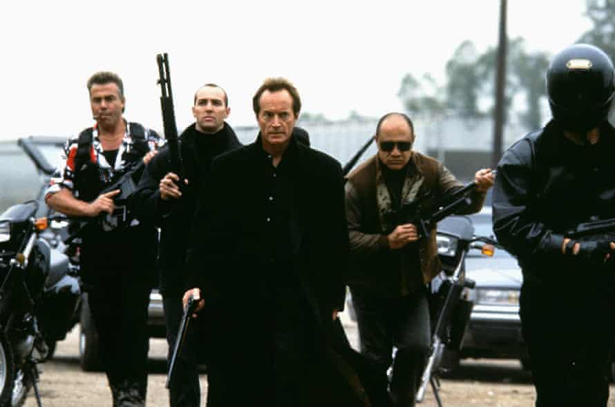 Lance Henriksen, as Emil Fouchon, and various honchos in Hard Target.