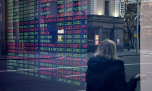 Market movements at the Australian Stock Exchange in Sydney on Wednesday. The benchmark ASX200 index rose despite the treasurer admitting the country was heading into its first recession for 30 years.