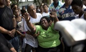 Wania de Moraes grieves for her 13-year-old son Jeremias Moraes da Silva during his burial service, in Rio de Janeiro, Brazil.