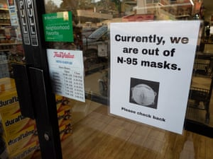 A sign hangs on a True Value hardware store, stating protective masks are sold out, in Orinda, California