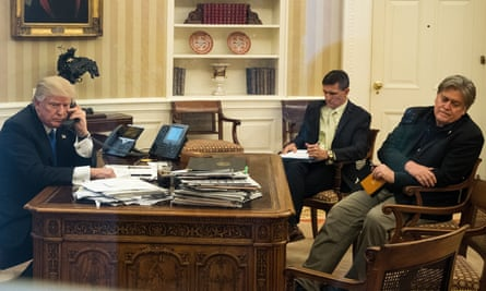 Flynn in the Oval Office with Trump and aide Steve Bannon in January 2017.