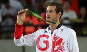 Andy Murray receives his gold medal on Sunday.