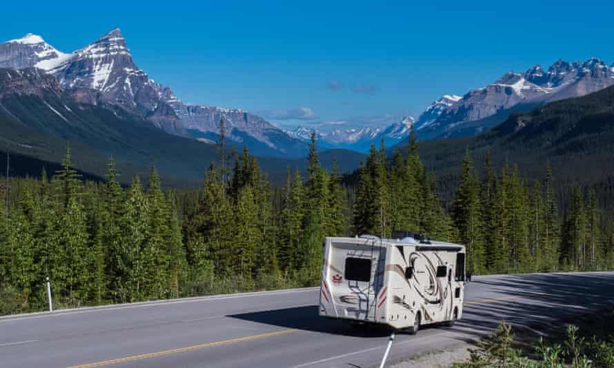 A motorhome driving through Banff national park in Alberta, Canada.