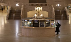 A traveler stands at the information desk at Grand Central Terminal, Tuesday, March 17, 2020, in New York.