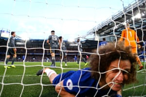 David Luiz bites the net in frustration after missing a chance.