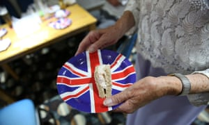 Woman holding a Union Jack plate at a Ukip event in Clacton