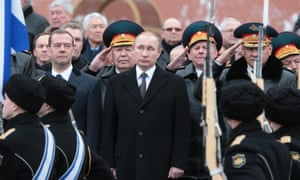 Russia's prime minister Dmitry Medvedev (L), president Vladimir Putin (C), and defence minister Sergei Shoigu (R) during a wreath laying ceremony.