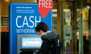 A Nationwide customer uses a free cash machine