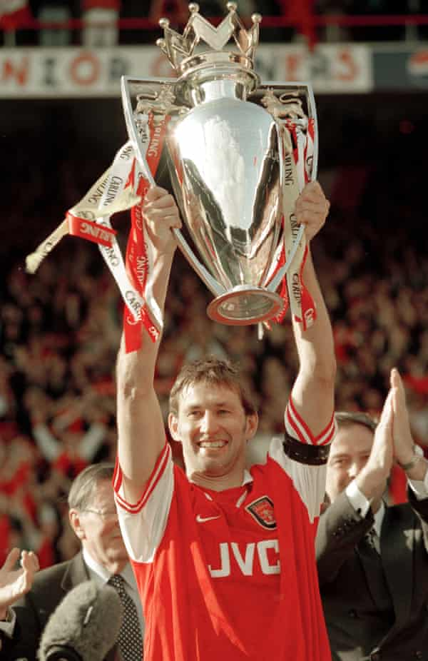 Tony Adams lifts the Premiership trophy after the final home game of the season at Highbury in 1998
