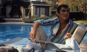 Robert Evans studying a script by the pool at his home in Beverly Hills, California, 1968.