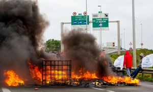 Striking employees of the French company My Ferry Link, stand in front of burning tyres in Calais.