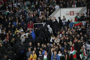 Bulgarian fans leave the stadium after the match was stopped for a second time.