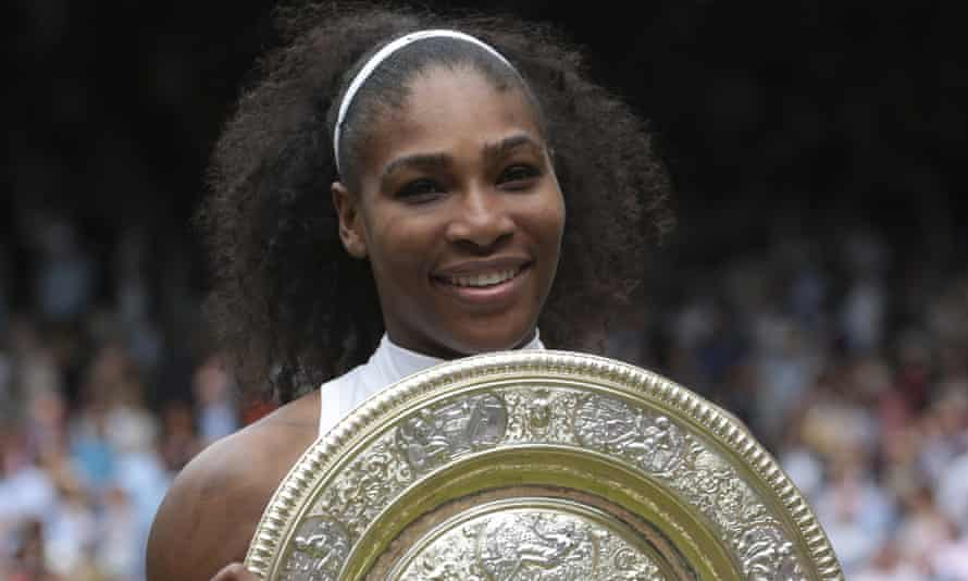 Serena Williams holds the Wimbledon trophy