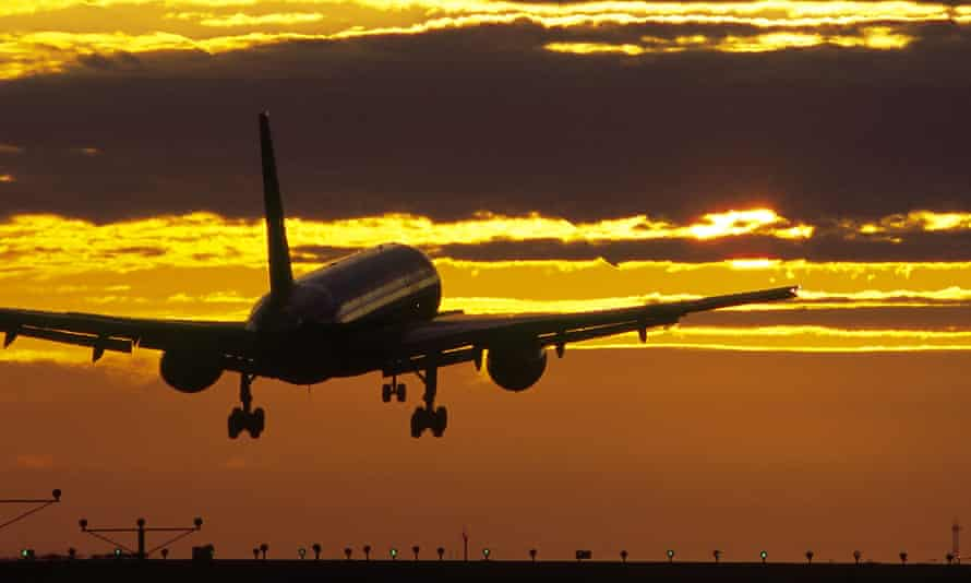 A Boeing 737 lands at sunset