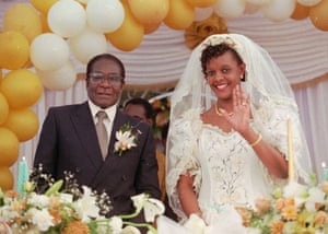 1996: Grace Mugabe waves at guests on 17 August after her wedding ceremony at the Kutama Catholic mission 42 miles west of Harare