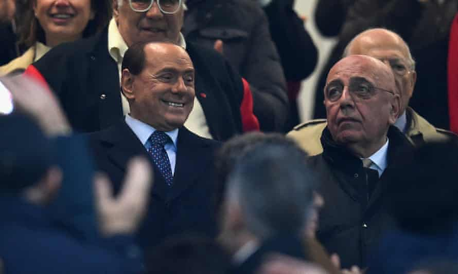 Silvio Berlusconi, left, and Adriano Galliani attend the Serie A match between Milan and Inter in November last year.