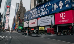 """Messages of support for healthcare workers and essential employees cover the electronic billboards of a Times Square on April 17, 2020 in New York City. The """"crossroads of the world"""" has become a ghost town during the coronavirus pandemic."""