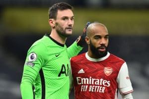 Frenchmen Lloris and Lacazette embrace after Arsenal go close