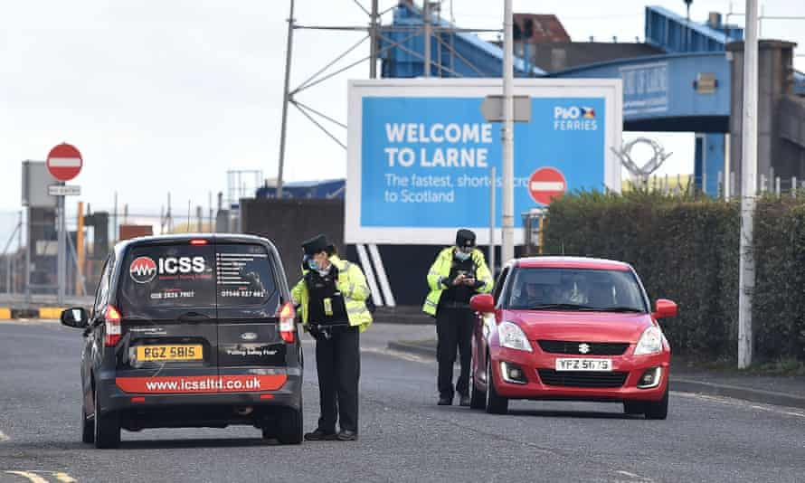 PSNI officers man a police checkpoint at Larne harbour on February 10, 2021 in Larne, Northern Ireland.