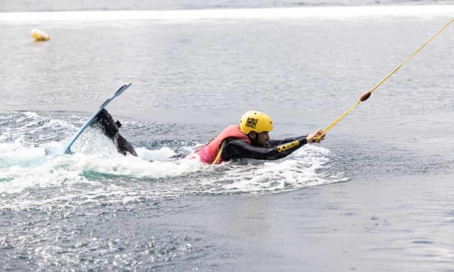 Rhik Samadder being dragged through the water while learning to wakeboard