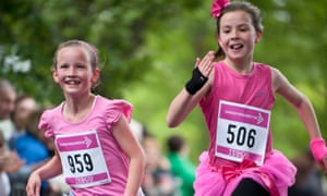 two young girls running to raise money for cancer research charity