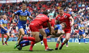 Liam Sutcliffe fights his way over for Leeds's first try against London Broncos at Anfield.