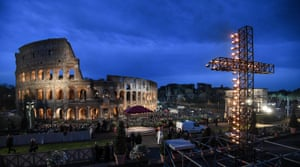 A candlelit cross outside the Colosseum in Rome, Italy.