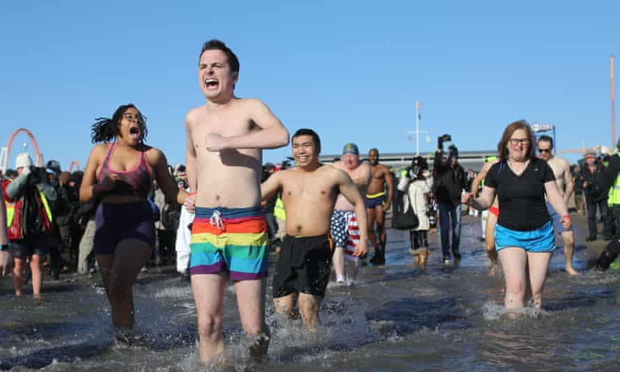 Participants rush in the water during a polar bear plunge at the beach in Coney Island in New York.