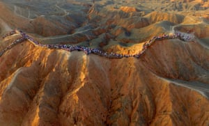 An aerial view shows people visiting an area of the Danxia landform geological park in Zhangye, China