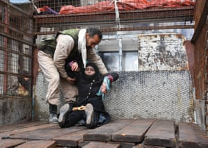 Aleppo, SyriaA wounded woman is helped onto the back of a truck as she flees the embattled city
